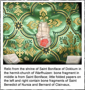 Relic from the shrine of Saint Boniface of Dokkum in the hermit-church of Warfhuizen: bone fragment in middle is from Saint Boniface; little folded papers on the left and right contain bone fragments of Saint Benedict of Nursia and Bernard of Clairvaux